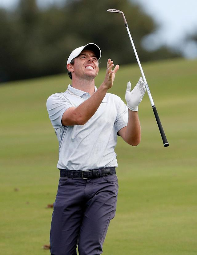 Rory McIlroy tosses his club after his approach shot on the 12th green during the third round of the Tournament of Champions golf event, Saturday, Jan. 5, 2019, at Kapalua Plantation Course in Kapalua, Hawaii. (AP Photo/Matt York)