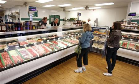 Customers wait to be served at Casey's Market in Western Springs, Illinois