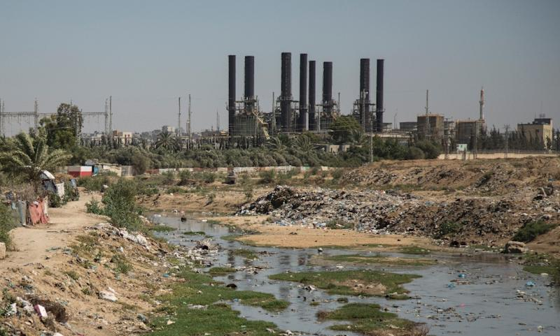 Sewage water runs next to the Nuseirat power plant in the Gaza Strip in this file picture taken on June 10, 2017