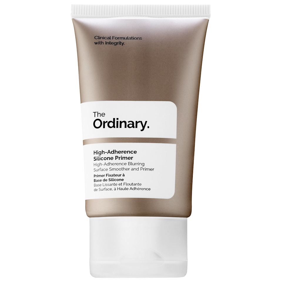 """The first thing I noticed about The Ordinary's High-Adherence Silicone Primer was its texture, which feels just like a creamy moisturizing lotion. Once applied, it made my skin feel so soft that I almost didn't want to put on makeup for fear of losing the silkiness. I, of course, eventually did, and it was a good thing: My makeup went on smooth and stayed matte throughout the day. My one complaint is that I wish the labeling explained the effects it would have, since I probably would have totally passed by this in a store for that reason. But at least now <em>you</em> know. <em>—Marla Goller, supervising video producer</em> $5, The Ordinary. <a href=""""https://shop-links.co/1677339438714609590"""" rel=""""nofollow noopener"""" target=""""_blank"""" data-ylk=""""slk:Get it now!"""" class=""""link rapid-noclick-resp"""">Get it now!</a>"""