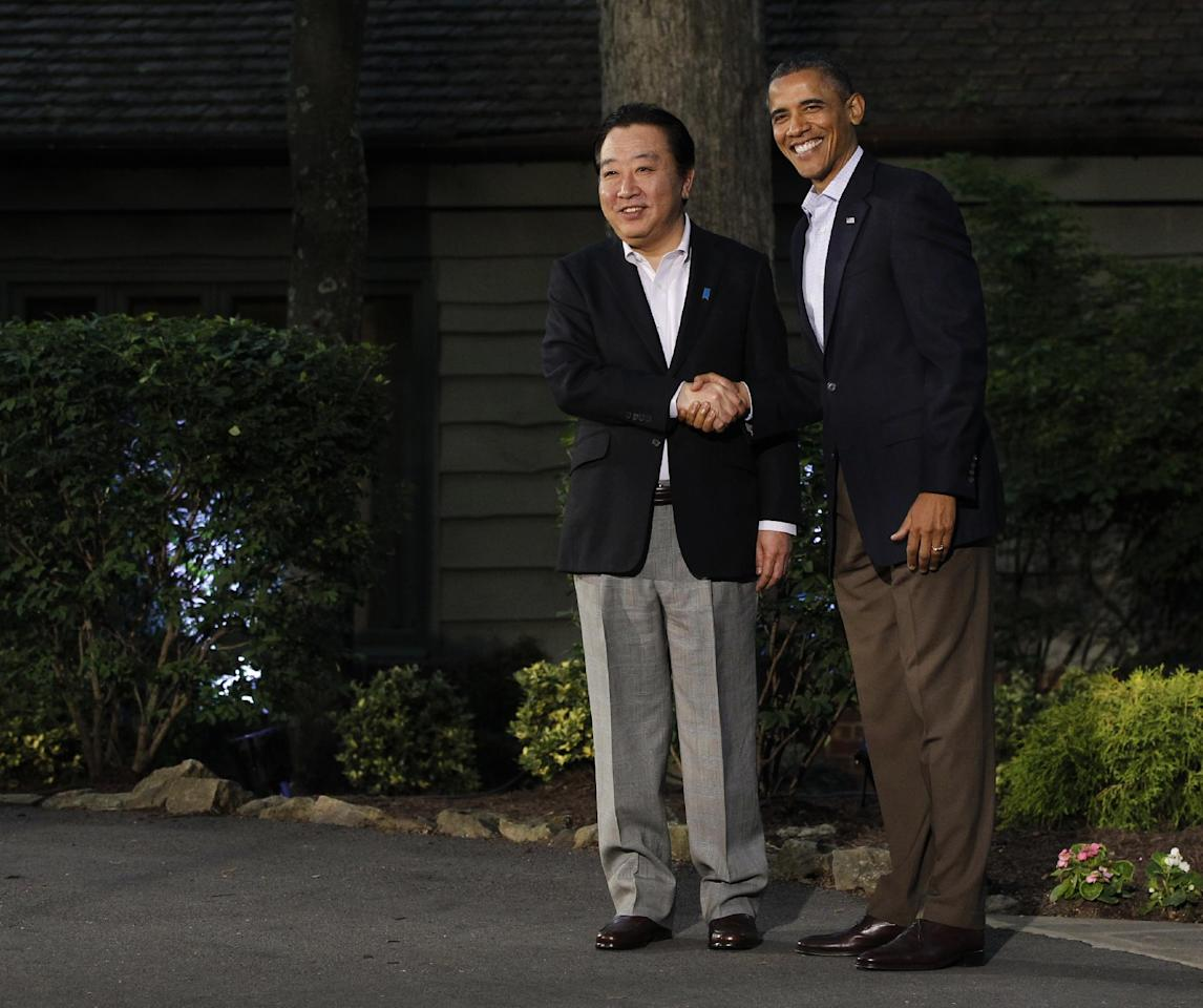 President Barack Obama, right, greets Japan's Prime Minister Yoshihiko Noda on arrival for the G8 Summit Friday, May 18, 2012 at Camp David, Md. (AP Photo/Charles Dharapak)