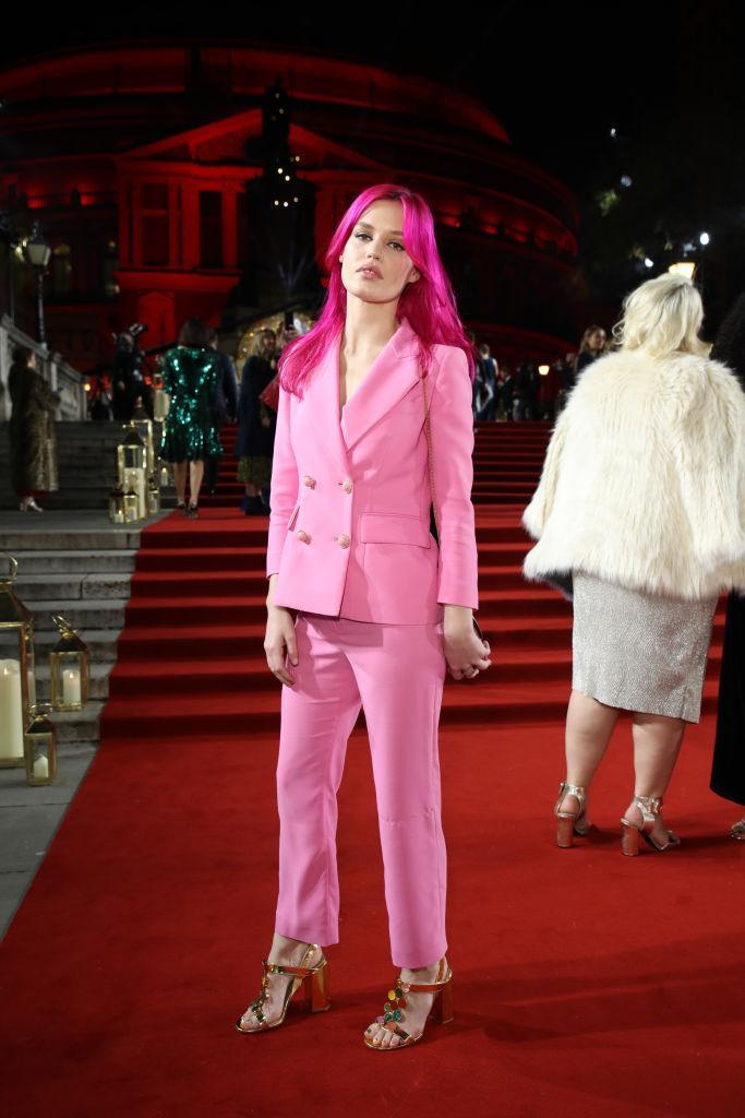 <p>Georgia May Jagger debuted hot pink hair at the fashion event to accessorise her candy floss-hued suit. <em>[Photo: Getty]</em> </p>