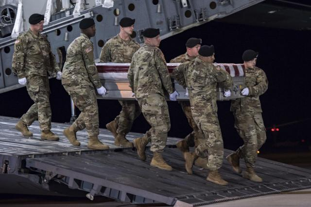"Soldiers from the Third U.S. Infantry Regiment carry the transfer case during a ""casualty return"" for Staff Sgt. Dustin M. Wright, of Lyons, Ga., at Dover Air Force Base, Del. (Photo: Pfc. Lane Hiser/U.S. Army via AP)"