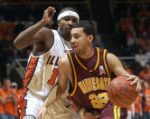 FILE - In this March 9, 2003, file photo, Minnesota's Ben Johnson (22) drives past Illinois Dee Brown (11) in the first half at Assembly Hall in Champaign, Ill. Minnesota has picked former player and assistant Johnson to be the new head men's basketball coach, according to a person with knowledge of the hire. The person spoke to The Associated Press on condition of anonymity because university had yet to make the announcement. (AP Photo/John Dixon, File)