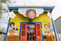 "<p>The Georgia on My Mind house float highlights politicians Stacey Abrams, Raphael Warnock, Jon Ossoff, Shortly Chisholm, and John Lewis. Signage saying ""Good Trouble"" and ""Bright Future"" accompanied by Georgia peaches hang on either side of the house.</p>"