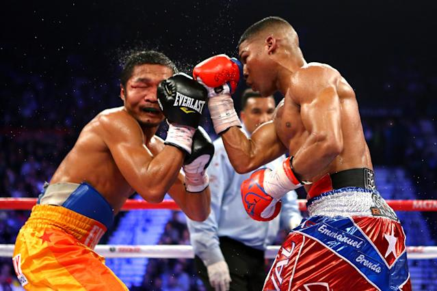 LAS VEGAS, NV - DECEMBER 08: (R-L) Yuriorkis Gamboa throws a right at Michael Farenas during their super featherweight bout at the MGM Grand Garden Arena on December 8, 2012 in Las Vegas, Nevada. (Photo by Al Bello/Getty Images)
