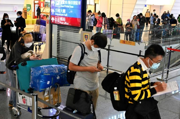 Passengers waiting for government-assigned taxis in March 2020 at Taoyuan Airport in Taiwan, which has required everyone arriving into the country to self-quarantine for two weeks as a preventive measure against the spread of the new coronavirus (AFP Photo/Sam Yeh)