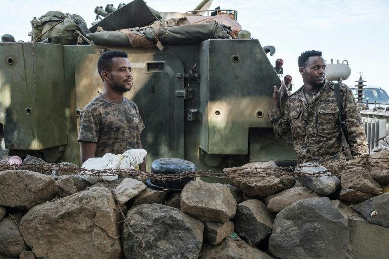 Ethiopian soldiers pictured last November at a military camp in the Tigrayan town Dansha where the first shots in the conflict were reputedly fired