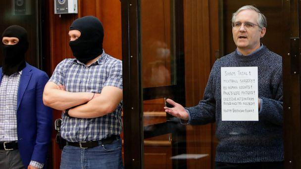 PHOTO: Former U.S. Marine Paul Whelan, who was detained and accused of espionage, holds a sign as he stands inside a defendants' cage during his verdict hearing in Moscow, June 15, 2020. (Maxim Shemetov/Reuters)
