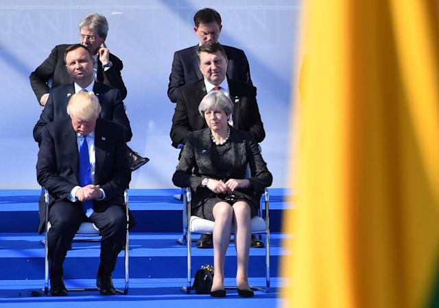 <p>British Prime Minister Theresa May, right, sits next to U.S. President Donald Trump during a ceremony at the NATO summit in Brussels on Thursday, May 25, 2017. US President Donald Trump and other NATO heads of state and government on Thursday will inaugurate the new headquarters as well as participating in an official working dinner. (AP Photo/Geert Vanden Wijngaert, Pool) </p>