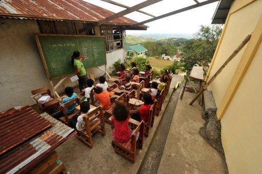 Ayta elementary students attend a class in a classroom at the Camias Resettlement Elementary School in Porac, north of Manila. Up to 50 of the country's minor languages could be lost within 20 years, according to anthropologist Artemio Barbosa