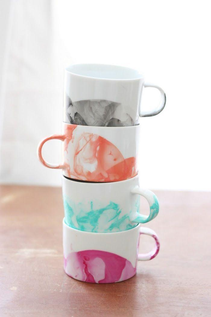 """<p>Give her mornings a bright boost with these marbled mugs. The materials you'll need to create them will cost you less than $5.</p><p><strong>Get the tutorial at <a href=""""http://diycandy.com/2015/04/diy-marbled-mugs-with-nail-polish/"""" rel=""""nofollow noopener"""" target=""""_blank"""" data-ylk=""""slk:DIY Candy"""" class=""""link rapid-noclick-resp"""">DIY Candy</a>.</strong></p><p><a class=""""link rapid-noclick-resp"""" href=""""https://go.redirectingat.com?id=74968X1596630&url=https%3A%2F%2Fwww.walmart.com%2Fbrowse%2Farts-crafts-sewing%2Fcraft-storage%2F1334134_6355365_1285843&sref=https%3A%2F%2Fwww.thepioneerwoman.com%2Fholidays-celebrations%2Fgifts%2Fg32307619%2Fdiy-gifts-for-mom%2F"""" rel=""""nofollow noopener"""" target=""""_blank"""" data-ylk=""""slk:SHOP CRAFT STORAGE"""">SHOP CRAFT STORAGE</a><strong><br></strong></p>"""