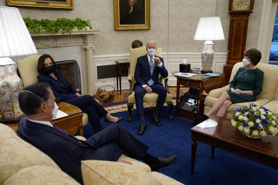 FILE - In this Feb. 1, 2021, file photo President Joe Biden and Vice President Kamala Harris meet with Sen. Mitt Romney, R-Utah, Sen. Susan Collins, R-Maine, and others to discuss a coronavirus relief package, in the Oval Office of the White House in Washington. (AP Photo/Evan Vucci, File)