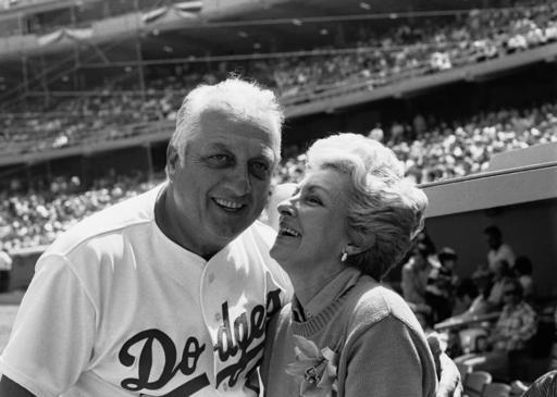 FILE - Jo Lasorda, wife of Los Angeles Dodgers' manager Tommy Lasorda, leans up to give him a good luck kiss on the start of his 35th season with the Dodger organization, in Los Angeles in this April 4, 1984, file photo. Tommy Lasorda, the fiery Hall of Fame manager who guided the Los Angeles Dodgers to two World Series titles and later became an ambassador for the sport he loved during his 71 years with the franchise, has died. He was 93. The Dodgers said Friday, Jan. 8, 2021, that he had a heart attack at his home in Fullerton, California. (AP Photo/Lennox Mclendon, File)