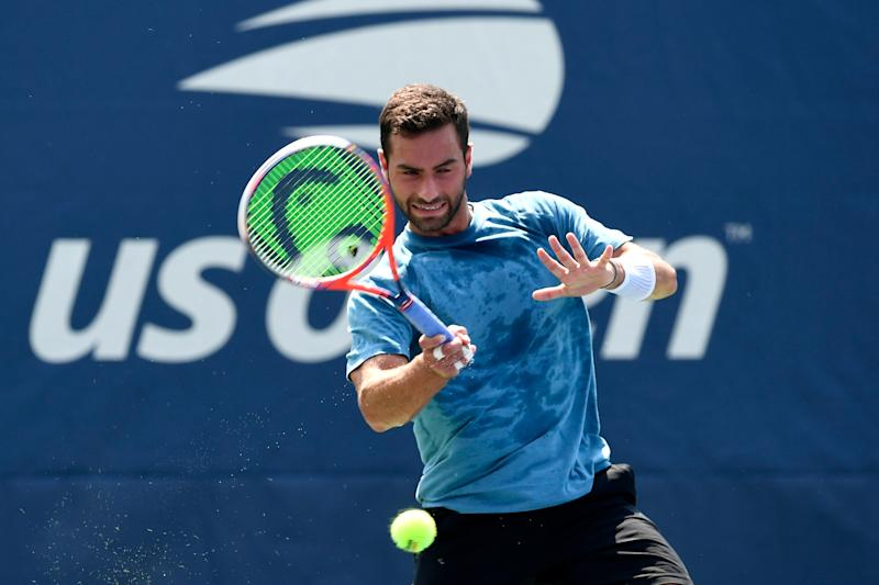 Noah Rubin hits a forehand during his men's singles first round match.