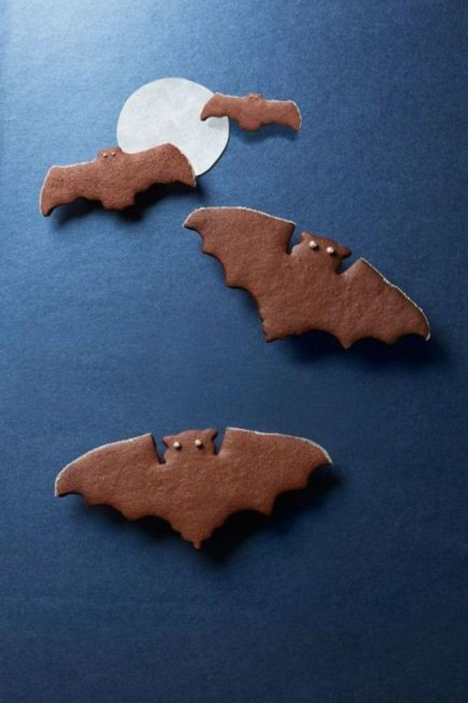 """<p>With a little kick, these chocolate spice bats will take over the night.</p><p><em><strong><a href=""""https://www.womansday.com/food-recipes/food-drinks/recipes/a40295/spiced-chocolate-bat-cookies-recipe-clx1014/"""" rel=""""nofollow noopener"""" target=""""_blank"""" data-ylk=""""slk:Get the Spiced Chocolate Bat Cookies recipe."""" class=""""link rapid-noclick-resp"""">Get the Spiced Chocolate Bat Cookies recipe.</a></strong></em></p>"""