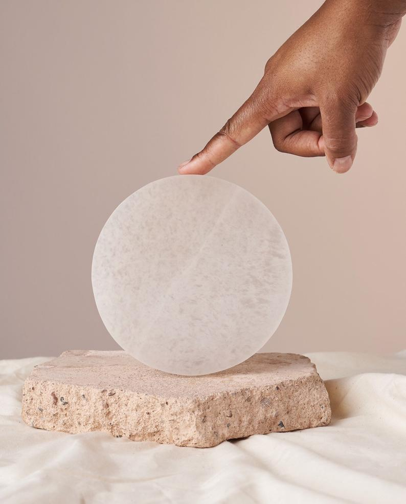 "<h2>Heritage Apothecary Selenite Charging Plate</h2><br>Crystals are such personal stones, so if your friend is a fan, you may want to consider this charging plate (rather than trying to pick a crystal for them). <a href=""https://www.refinery29.com/en-us/selenite-wand-meaning-healing-crystal"" rel=""nofollow noopener"" target=""_blank"" data-ylk=""slk:Selenite"" class=""link rapid-noclick-resp"">Selenite</a> is the only crystal that has the power to cleanse <em>other</em> crystals, making the plate the perfect storage spot for a friend's budding stone collection. <br><br><strong>Heritage Apothecary</strong> Selenite Charging Plate, $, available at <a href=""https://go.skimresources.com/?id=30283X879131&url=https%3A%2F%2Fwww.etsy.com%2Flisting%2F826629396%2Fselenite-charging-plates"" rel=""nofollow noopener"" target=""_blank"" data-ylk=""slk:Etsy"" class=""link rapid-noclick-resp"">Etsy</a>"