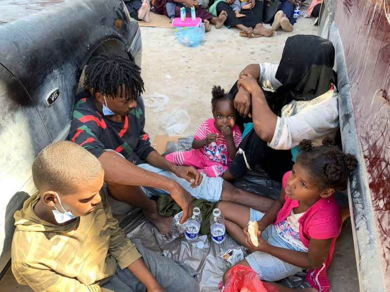 Migrants take rest as they waits outside the United Nations High Commissioner for Refugees (UNHCR) negotiation office in Tripoli