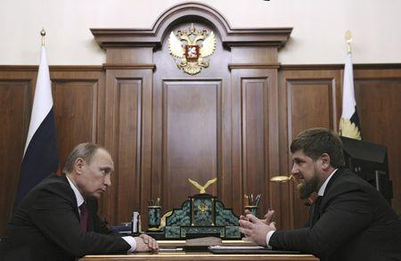 Russian President Vladimir Putin (L) meets with Chechnya's leader Ramzan Kadyrov at the Kremlin in Moscow, Russia, in this December 10, 2015 file photo. REUTERS/Mikhail Klimentyev/Sputnik/Kremlin/Files