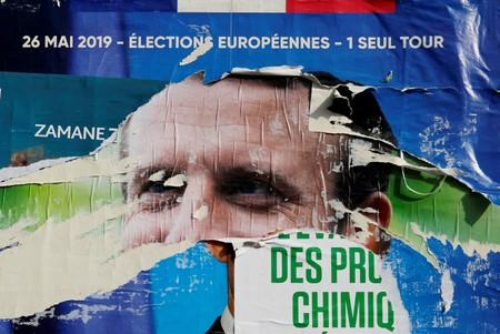FILE PHOTO: Torn and overlapping official posters of candidates for the 2019 European parliament elections including a poster of French President Emmanuel Macron as the cover for the Renaissance (Renewal) list, are seen in Cambrai