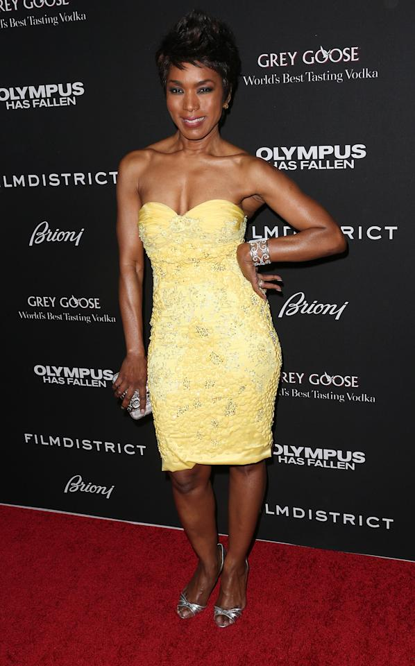 "HOLLYWOOD, CA - MARCH 18: Actress Angela Bassett attends the Premiere of FilmDistrict's ""Olympus Has Fallen"" at the ArcLight Cinemas Cinerama Dome on March 18, 2013 in Hollywood, California.  (Photo by Frederick M. Brown/Getty Images)"