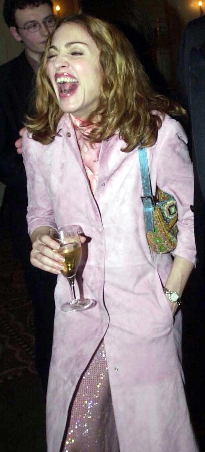 We're not sure what this pink coat is, exactly, but we're glad she's having a nice time wearing it.