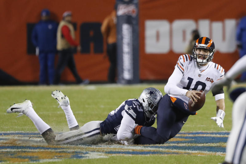 Chicago Bears quarterback Mitchell Trubisky (10) is sacked by Dallas Cowboys' Darian Thompson (23) during the first half of an NFL football game, Thursday, Dec. 5, 2019, in Chicago. (AP Photo/Charles Rex Arbogast)