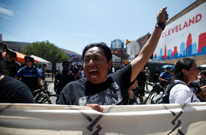 """<p>A protester yells as part of """"Wall Off Trump"""" march near an entrance to the arena hosting the Republican National Convention in Cleveland on July 20, 2016. (Photo: Jim Urquhart/Reuters</p>"""