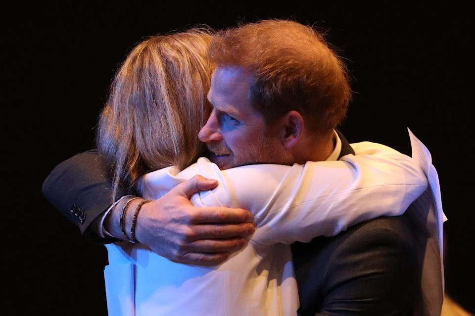 EDINBURGH, SCOTLAND - FEBRUARY 26: Prince Harry, Duke of Sussex receives a hug as he greets guests at a sustainable tourism summit at the Edinburgh International Conference Centre on February 26, 2020 in Edinburgh, Scotland. (Photo by Andrew Milligan-WPA Pool/Getty Images)