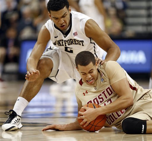 Boston College's Ryan Anderson, bottom, tries to recover the ball as Wake Forest's Devin Thomas, top, defends during the first half of an NCAA college basketball game in Winston-Salem, N.C., Saturday, Jan. 12, 2013. (AP Photo/Chuck Burton)