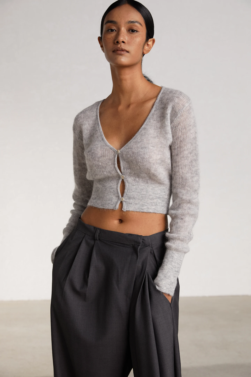 "Midriffs were out for the world to see during spring '21 fashion month, so obviously your fashion friend needs to get in on the trend stat.<br><br><strong>The Source Unknown</strong> Fuzzy Mohair Cardigan, $, available at <a href=""https://go.skimresources.com/?id=30283X879131&url=https%3A%2F%2Fthesourceunknown.com%2Fcollections%2Fnew-in%2Fproducts%2Ffuzzy-mohair-cardigan-light-grey"" rel=""nofollow noopener"" target=""_blank"" data-ylk=""slk:The Source Unknown"" class=""link rapid-noclick-resp"">The Source Unknown</a>"