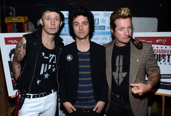 "Mike Dirnt, Billie Joe Armstrong and Tre Cool of Green Day pose backstage for a picture before the World Premiere of ""Broadway Idiot"" during the 2013 SXSW Music, Film + Interactive Festival at the Paramount Theatre on March 15, 2013 in Austin, Texas."