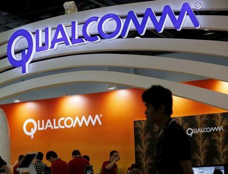 FILE PHOTO: Qualcomm's logo is seen at its booth at the Global Mobile Internet Conference (GMIC) 2015 in Beijing