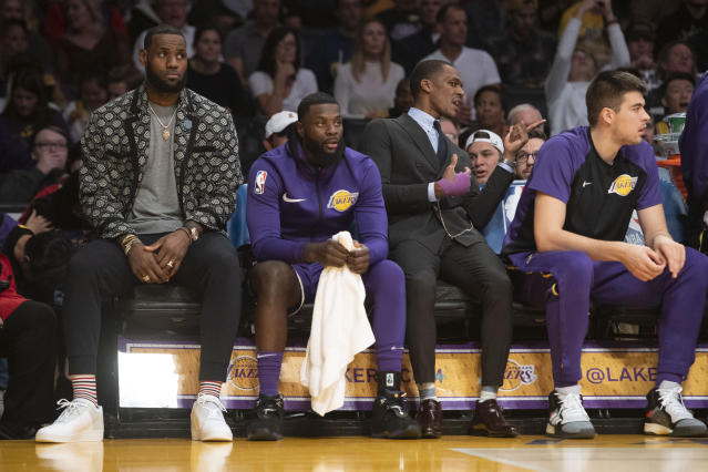 A groin injury has relegated LeBron James to a being a spectator for the last eight Lakers games. (Getty)