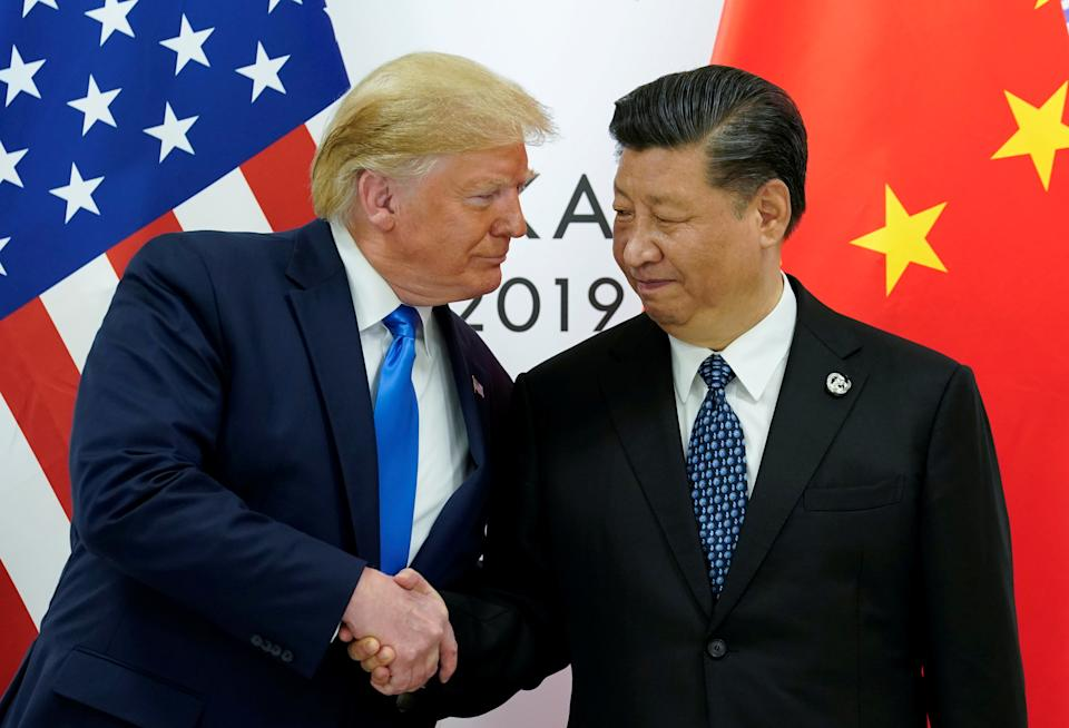 Photo shows US President Donald Trump shaking hands with China's President Xi Jinping.