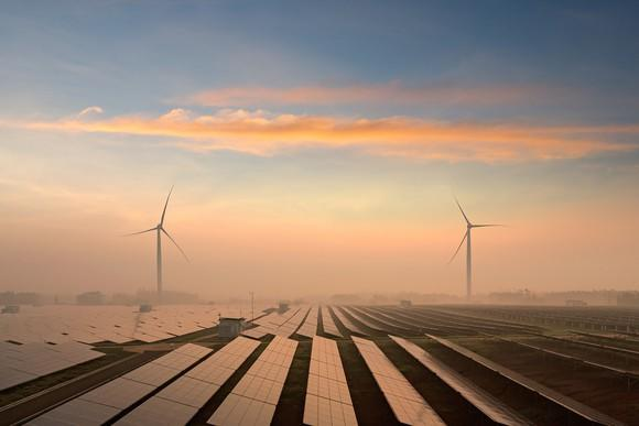 Wind turbines and solar panels in a utility-scale project.