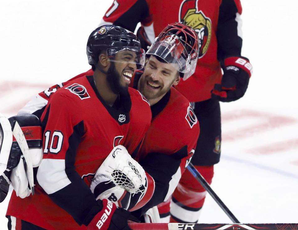Ottawa Senators left wing Anthony Duclair (10) celebrates his game-winning goal and hat trick with goaltender Anders Nilsson (31) following overtime against the Columbus Blue Jackets in an NHL hockey game in Ottawa, Saturday, Dec. 14, 2019. (Fred Chartrand/The Canadian Press via AP)
