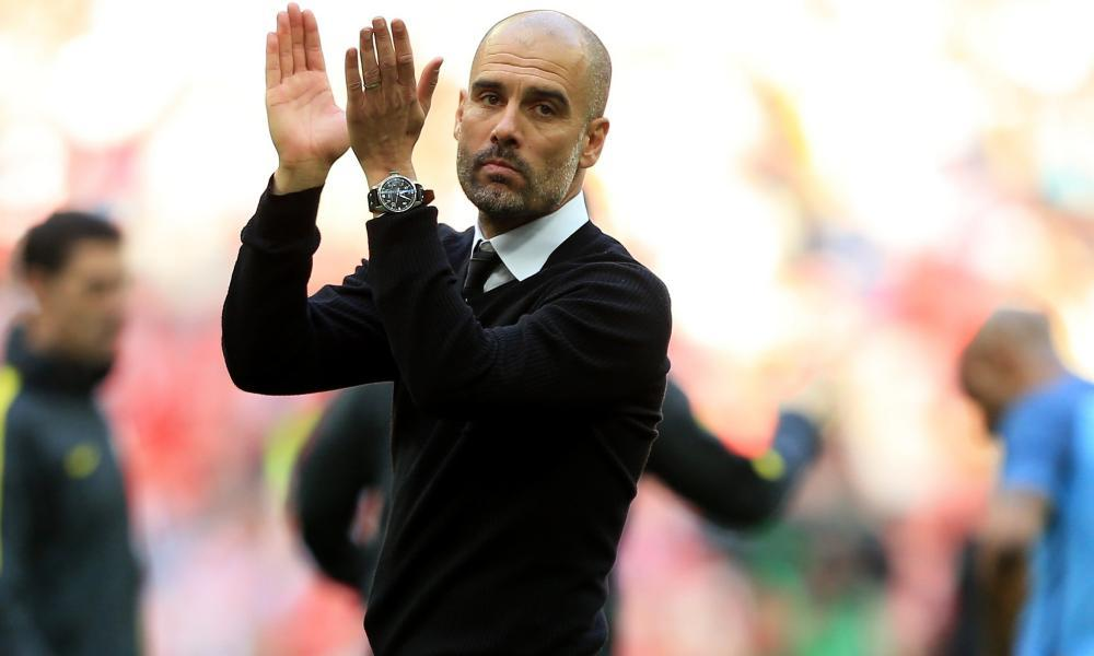 Manchester City manager Pep Guardiola looks dejected at Wembley.
