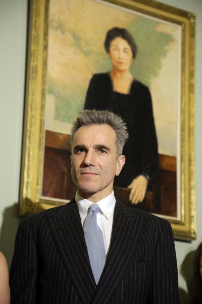 """Cast member Daniel Day-Lewis stands in front of a portrait of Sen. Hattie Caraway from Arkansas, during a media availability before a screening of the movie """"Lincoln,"""" for members of Congress, on Capitol Hill Wednesday, Dec. 19, 2012 in Washington. (AP Photo/Alex Brandon)"""