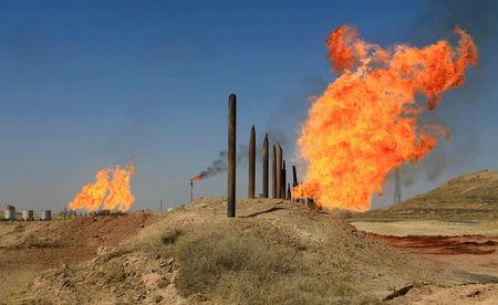 Flames emerge from flare stacks at the oil fields in Kirkuk, Iraq October 18, 2017. REUTERS/Alaa Al-Marjani/Files