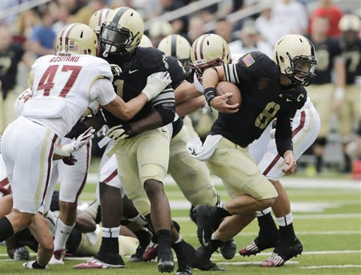 Army quarterback Trent Steelman (8) runs for a touchdown against Boston College during the first half of an NCAA college football game Saturday, Oct. 6, 2012, in West Point, N.Y. (AP Photo/Mike Groll)