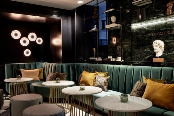 Prop yourself up in the green velvet bar (Academia of Athens)