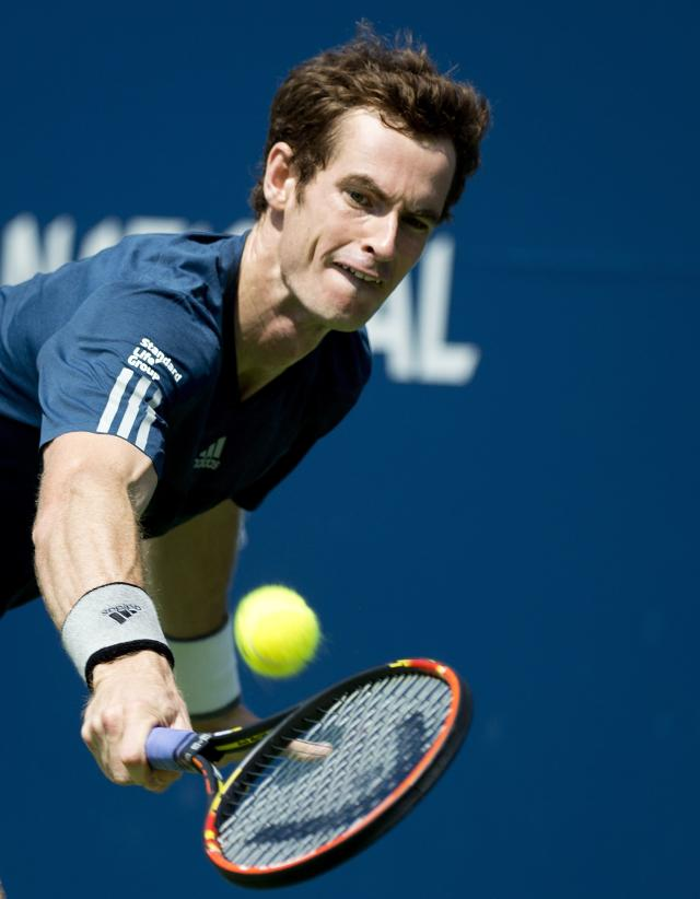 Andy Murray of Great Britain returns the ball against Nick Kyrgios of Australia during a men's third round match at the Rogers Cup tennis tournament in Toronto on Wednesday, Aug. 6, 2014. (AP Photo/The Canadian Press, Nathan Denette)