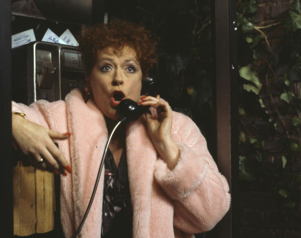 Actress Eileen Pollock using a telephone in a scene from the Christmas special of the BBC television sitcom 'Bread', November 11th 1990. (Photo by Don Smith/Radio Times/Getty Images)