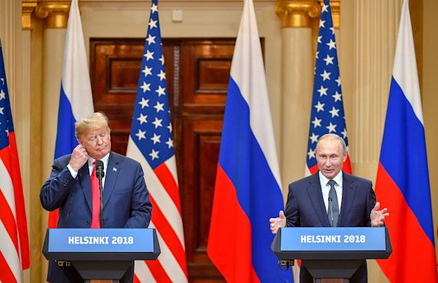 <p>U.S. President Donald Trump (L) and Russia's President Vladimir Putin attend a joint press conference after a meeting at the Presidential Palace in Helsinki, on July 16, 2018. (Photo: Yuri Kadobnov/AFP/Getty Images) </p>
