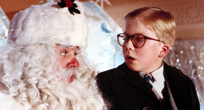 Santa Claus and a little boy in a move still from 'A Christmas Story'