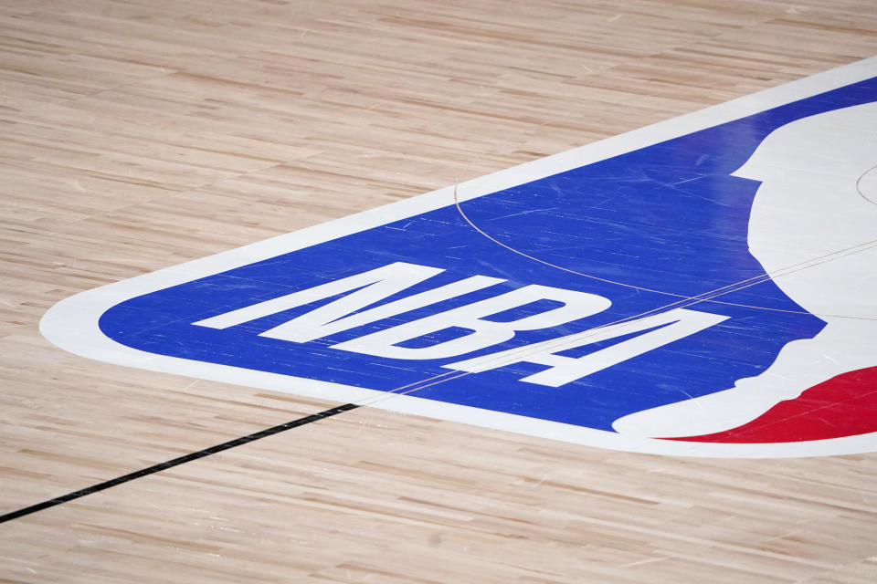 The NBA logo at center court is shown during the second half of an NBA first-round playoff basketball game between the Houston Rockets and Oklahoma City Thunder in Lake Buena Vista, Fla., Wednesday, Sept. 2, 2020. (AP Photo/Mark J. Terrill)