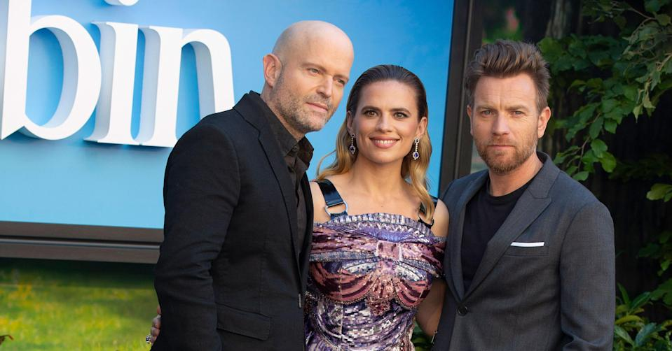 Marc Forster poses with Christopher Robin stars Ewan McGregor and Hayley Atwell (PA Images).