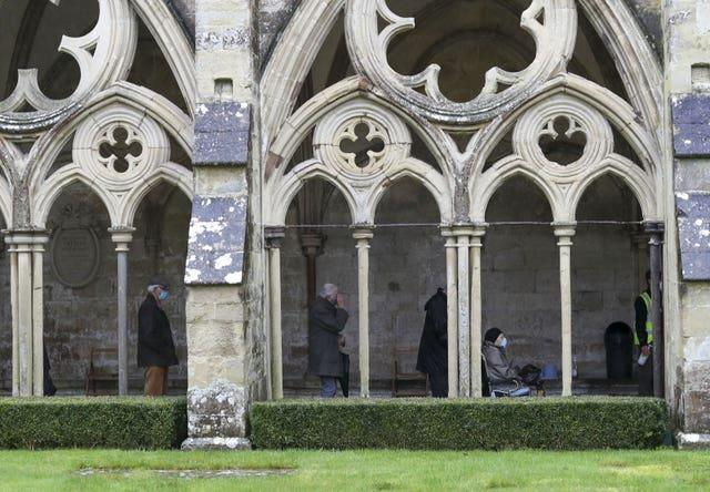 People queue outside Salisbury Cathedral, Wiltshire, to receive a jab (Steve Parsons/PA)