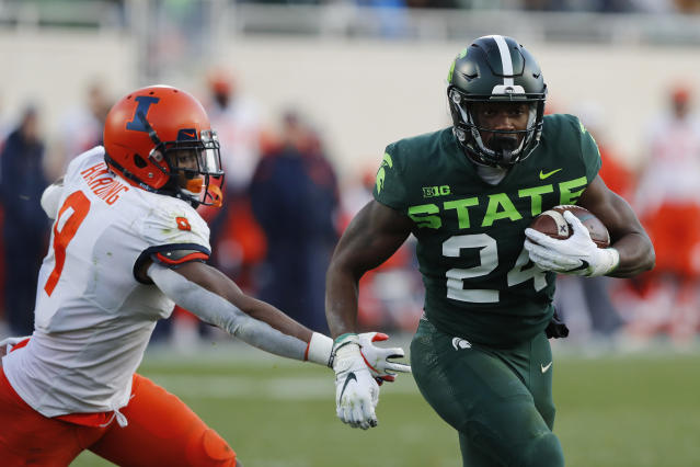 Michigan State running back Elijah Collins (24) pulls away from Illinois linebacker Dele Harding (9) for a touchdown during the first half of an NCAA college football game, Saturday, Nov. 9, 2019, in East Lansing, Mich. (AP Photo/Carlos Osorio)